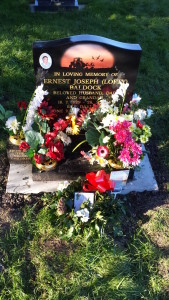Dad's grave, with floral tributes