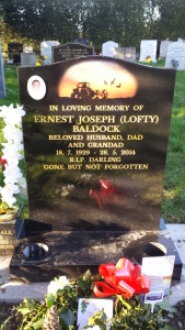 Dad's headstone, showing flower pots